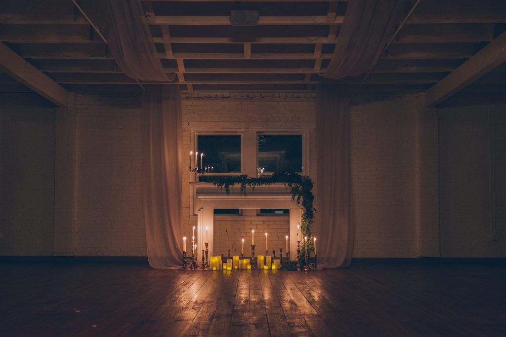 Ceremony Backdrop inspiration: rent this gorgeous fireplace mantel and stage it with candles and greenery for your wedding ceremony.